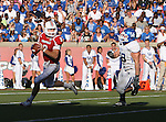 UofL's quarterback Adam Froman scrambles from UK's Luke McDermott at Papa John's Cardinal Stadium on Saturday, Sept. 4, 2010. Photo by Scott Hannigan | Staff