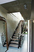 The made-to-measure steel and wood staircase connects all five floors of the house