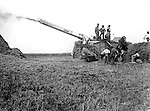 Client: J.I. Case Company<br /> Product: Case Steam Threshing Machine<br /> Ad Agency: Photograph used in Case Product Advertising<br /> <br /> Westmoreland County PA:  Case all-steel Threshing Machine operating on a farm - 1912. Brady Stewart was hired by Case to photograph the new machine for a brochure.