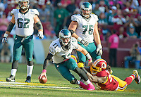 Philadelphia Eagles quarterback Carson Wentz (11) is sacked by Washington Redskins defensive end Ricky Jean Francois (99) in fourth quarter action at FedEx Field in Landover, Maryland on Sunday, October 16, 2016.<br /> The Redskins won the game 27 - 20.<br /> Credit: Ron Sachs / CNP /MediaPunch