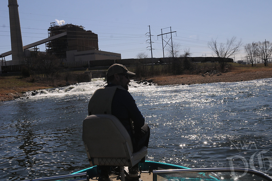 NWA Democrat-Gazette/FLIP PUTTHOFF <br /> Jon Stein, fisheries biologist with the Arkansas Game and Fish Commission, fishes for black bass Feb. 17 2017 at Swepco Lake near the hot water discharge from the Flint Creek Power Plant west of Gentry. Water is drawn from the lake in the process of making electricity, then discharged back into the lake at a temperature of about 100 degrees. That keeps water temperature warm all winter.
