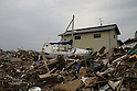 The city of Natori became famous as the live broadcast of the tsunami tearing through it was seen around the world.  A month and a half later, rebuilding is still a distant thought.  Families struggle to sort through their heavily damaged homes.  Boats, carried on the initial wave, came to rest in yards, fields and homes in the Nakazuka area...