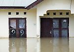 Questions arise during November 2014 flooding in Meulaboh in Indonesia's Aceh province. Flooding in the region has grown worse because of climate change and the proliferation of palm oil plantations.