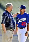 22 July 2011: Washington Nationals Clubhouse Manager Mike Wallace (left) chats with Dodgers bench coach Trey Hillman prior to a game against the Los Angeles Dodgers at Dodger Stadium in Los Angeles, California. The Nationals defeated the Dodgers 7-2 in their first meeting of the 2011 season. Mandatory Credit: Ed Wolfstein Photo