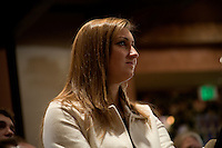 One of Ron Paul's granddaughter listens to congressman Ron Paul speak at a town hall meeting and rally at the Church Landing at Mills Falls hotel in Meredith, New Hampshire, on Jan. 8, 2012. Paul is seeking the 2012 Republican presidential nomination.