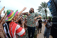 MIAMI BEACH , FL - AUGUST 13: Steve Aoki performs during the iHeart Radio Y-100 Mackapoolooza Pool Party at The Fountainbleu on August 13, 2016 in Miami Beach, Florida. Credit: mpi04/MediaPunch