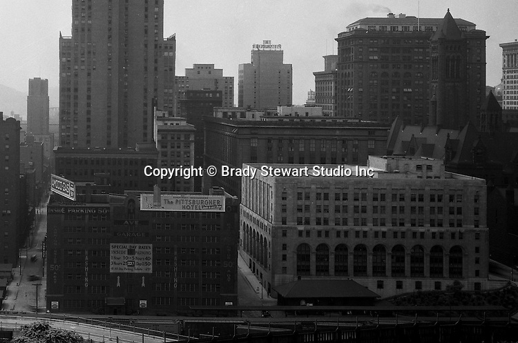 Pittsburgh PA:  View of the Pittsburgh skyline from Duquesne University - 1932.  View includes the Pittsburgh Hotel, Grant and Frick Buildings, City County Building and Jail.