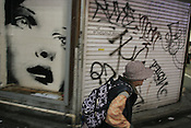 Graffiti and street scene in Shibuya district of Tokyo, Japan, on Saturday, Nov. 18, 2006.
