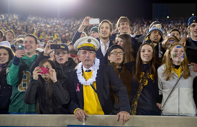Nov. 3, 2012; Students gather to watch and take photos of the players as they sing the Alma Mater after Notre Dame won 29-26 in triple overtime against Pittsburgh. Photo by Barbara Johnston/University of Notre Dame