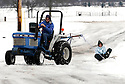 Joe Imel/Daily News.Hank Bormann pulls his daughter Sara behind his tractor Saturday on Bowie Drive. Snow moved into southcentral Kentucky nearly a half day later than expected but dumping about 6 inches in some areas before trailing off...