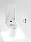 High Tech toilet with a remote control. Toto toilet with Washlet seat. Isolated with clipping path.