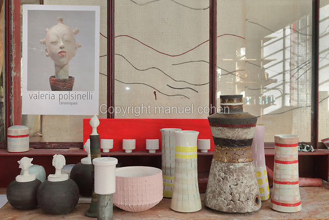 Collection of clay and porcelain bowls and vases in the studio of ceramicist Valeria Polsinelli, in Montreuil, a suburb of Paris, France. Polsinelli creates everyday vessels, water jugs, jewellery and figurines and stoppers of female busts, with features and hairstyles from various world cultures. Picture by Manuel Cohen