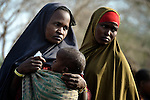 After trekking for a month across east Africa, two Somali women wait with their children to be registered in the Dadaab refugee camp in northeastern Kenya. Tens of thousands of newly arrived Somalis have swelled the population of what was already the world's largest refugee camp.