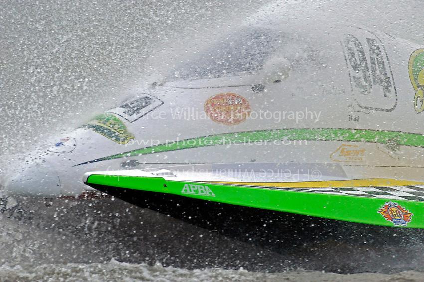 Paul Trolian, (#94) gets a face full of water.  (SST-45 class)