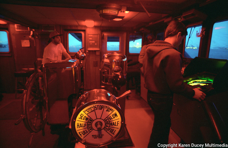 The captain and others in the wheelhouse of the seafood processor M/V Omnisea navigate the ship out of Dutch Harbor, Alaska on its way to St. Paul Harbor at the start of the opilio crab season in 1994.