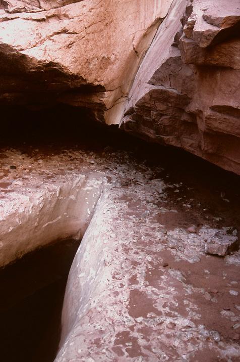 a sculptured pouroff runs through the Coconino Sandstone in Grand Canyon National Park, AZ