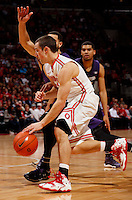 Ohio State Buckeyes guard Aaron Craft (4) brings the ball up court in the first half of their game against the Northwestern Wildcats at the Value City Arena in Columbus, Ohio on February 19, 2014. (Columbus Dispatch photo by Brooke LaValley)
