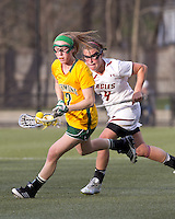 University of Vermont midfielder Natalie Jones (2) brings the ball forward as Boston College attacker Brooke Blue (4) pressures. Boston College defeated University of Vermont, 15-9, at Newton Campus Field, April 4, 2012.