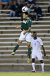 24 September 2013: William and Mary's Chris Dunn (8) heads the ball over North Carolina's Jordan McCrary (9). The University of North Carolina Tar Heels hosted the College of William and Mary Tribe at Fetzer Field in Chapel Hill, NC in a 2013 NCAA Division I Men's Soccer match. William and Mary won the game 1-0.