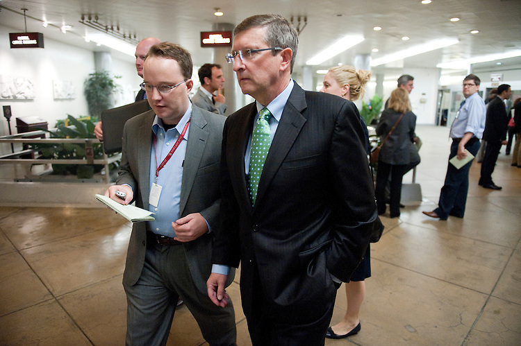 UNITED STATES - OCTOBER 4: Sen. Kent Conrad, D-N. Dak., speaks to a reporter as he arrives in the Capitol via the Senate Subway on Tuesday, Oct. 4, 2011. (Photo By Bill Clark/CQ Roll Call)
