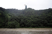 "A temple stands on a hill overlooking one of the main channels of the Dujiangyan Irrigation System. The system is regarded as an ""ancient Chinese engineering marvel."" By naturally channeling water from the Min River during times of flood, the irrigation system served to protect the local area from flooding and provide water to the Chengdu basin. Sichuan Province. 2010"