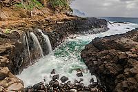 Shoreside waterfall, Hanalei Bay, on the island of Kauai, Hawaii. An interesting place to watch the pulsating sea.