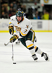 6 December 2009: University of Vermont Catamount forward Justin Milo, a Junior from Edina, MN, in action against the University of New Hampshire Wildcats at Gutterson Fieldhouse in Burlington, Vermont. The Wildcats defeated the Catamounts 5-2 in the Hockey East matchup. Mandatory Credit: Ed Wolfstein Photo
