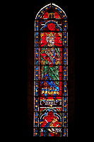 Medieval Window of the North Transept of the Gothic Cathedral of Chartres, France- Circa 1235. A UNESCO World Heritage Site. The panels depict King David with his harp with Saul dying on his own sword below .