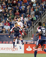 New England Revolution forward Diego Fagundez (14) and New York Red Bulls defender Heath Pearce (3) battle for head ball. Despite a red-card man advantage, in a Major League Soccer (MLS) match, the New England Revolution tied New York Red Bulls, 1-1, at Gillette Stadium on September 22, 2012.