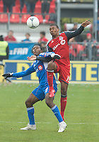 20 October 2012: Toronto FC midfielder Reggie Lambe #19 and Montreal Impact midfielder Patrice Bernier #8 in action during an MLS game between the Montreal Impact and Toronto FC at BMO Field in Toronto, Ontario..The game ended in a 0-0 draw..