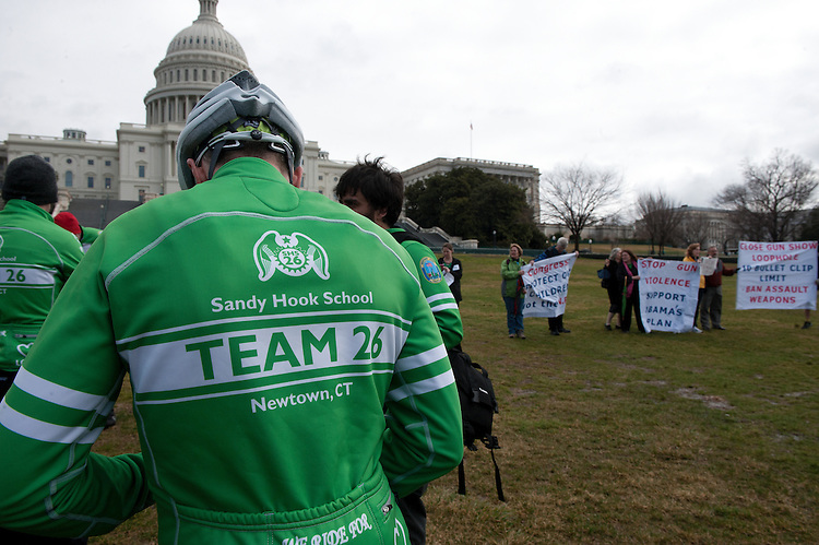 UNITED STATES - March 12 : Riders talk with press before the start of the press conference on the West Front Lawn of the U.S. Capitol.  The Sandy Hook Ride on Washington was  a team of 26 cyclists riding almost 400 miles from Newtown, Connecticut to the Capitol in Washington, DC in support of commonsense solutions to prevent gun violence.. (Photo By Douglas Graham/CQ Roll Call)