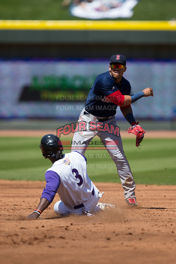 Yoan Moncada (19) of the Salem Red Sox follows through on his throw to first base as Marcus Davis (3) of the Winston-Salem Dash slides into second base at BB&T Ballpark on April 17, 2016 in Winston-Salem, North Carolina.  The Red Sox defeated the Dash 3-1.  (Brian Westerholt/Four Seam Images)
