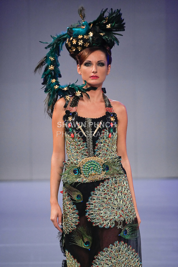 Model walks the runway in an outfit by Yana Benhuri for the YBCouture collection fashion show, during Couture Fashion Week Spring 2012.