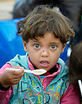 Ritan, a 4-year old refugee from Syria, enjoys some soup in a refugee processing center in the Serbian village of Presevo, not far from the Macedonian border. Hundreds of thousands of refugees and migrants from Syria, Iraq and other countries--including many children--have flowed through Serbia in 2015, on their way to western Europe. <br /> <br /> Parental consent obtained.