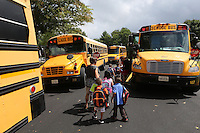 School buses line up to transport children from a school in Charlottesville, VA. Photo/Andrew Shurtleff