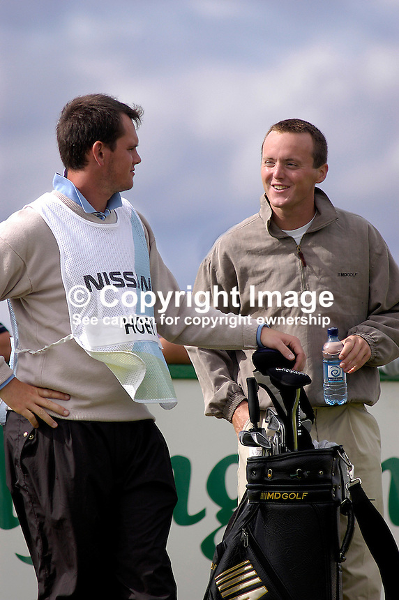 Johnny Foster, caddy, Ballyclare, Co Antrim (left), and Michael Hoey, professional golfer, N Ireland, UK. Taken at Nissan Irish Open, Portmarnock Golf Club, Ireland, in July 2003. Ref: 200307232719...Copyright Image from Victor Patterson, 54 Dorchester Park, Belfast, UK, BT9 6RJ..Tel: +44 28 9066 1296.Mob: +44 7802 353836.Voicemail +44 20 8816 7153.Skype: victorpattersonbelfast.Email: victorpatterson@mac.com.Email: victorpatterson@ireland.com (back-up)..IMPORTANT: If you wish to use this image or any other of my images please go to www.victorpatterson.com and click on the Terms & Conditions. Then contact me by email or phone with the reference number(s) of the image(s) concerned.