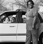 Selma Johnson, with her children, Precious, left, and Praises, outside of the Durham Public Library, April, 2008. ..Photo By Jeyhoun Allebaugh