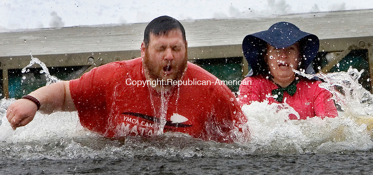 WATERTOWN CT. 15 February 2014-021514SV09-From left, Mike Tedesco, camp director, and Chelsea Ambrozaitis of Naugatuck take the plunge during the first Polar Plunge at YMCA's Camp Mataucha in Watertown Saturday.<br /> Steven Valenti Republican-American