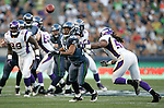 Seattle Seahawks wide receiver Golden Tate goes to catch a pass while being guarded by Minnesota Vikings  linebacker Jasper Brinkley at CenturyLink Field in Seattle, Washington August 20, 2011. The Vikings beat the Seahawks  20-7. ©2011 Jim Bryant Photo. All Rights Reserved.