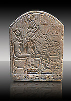 Ancient Egyptian limestone funerary stele showing Akhenaten and Nefertiti in front of an offering table. Ancient Egypt 18th Dynasty, 1345 BC. Neues Museum Berlin Cat No: AM 17813.