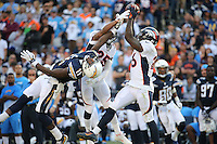 San Diego Chargers wide receiver Steve Johnson #11, Denver Broncos cornerback Chris Harris #25 and free safety Darian Stewart #26 during an NFL game between the Denver Broncos and the San Diego Chargers played at Qualcomm Stadium on December 6, 2015. (Michael Zito/AP for Panini
