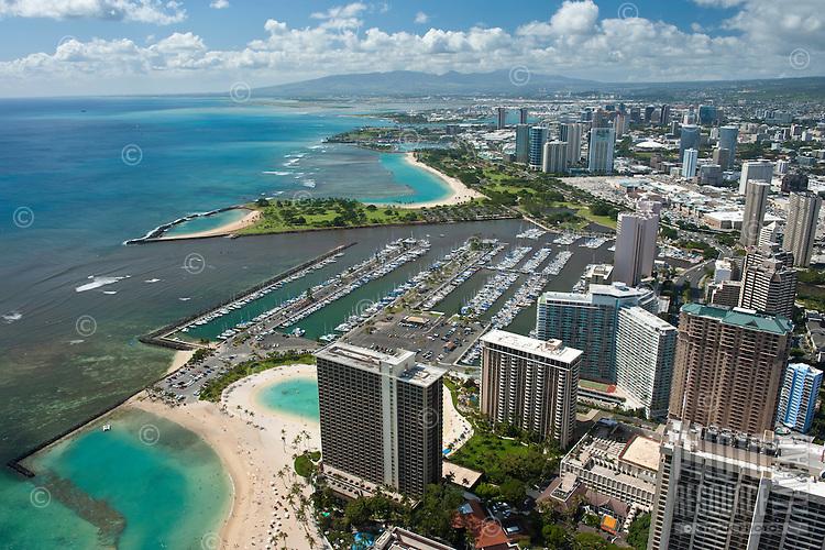 Aerial of Ala Wai boat harbor with Hilton Hwn Village, Magic Island and Ala Moana Shopping Center