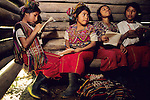 Ixil Indian children attend school in their village of Caba in the Highlands of Guatemala where they have fled with their parents to escape the internal conflict that raged there between 1960 and 1996.