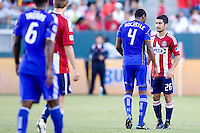 Kansas City Wizards midfielder Craig Rocastle and Chivas USA midfielder Paulo Nagamura exchange a few words with one another. The Kansas City Wizards defeated CD Chivas USA 2-0 at Home Depot Center stadium in Carson, California on Sunday September 19, 2010.