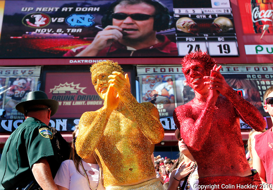 TALLAHASSEE, FL 10-FSU-BC 101610 FB10 CH-The Garnet and Gold guys applaud Florida State's 24-19 victory over Boston College Saturday at Doak Campbell Stadium in Tallahassee. .COLIN HACKLEY PHOTO