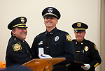 WINSTED,  CT-051817JS23-Winchester Police Officer of the Year, Officer Michael Gagne, center, share a laugh with Police Chief William T. Fitzgerald, Jr., left, as he recieves his award during the 2nd annual Winchester Police Department's Award Ceremony Thursday in the P. Francis Hicks Room at Winchester Town Hall. <br /> Jim Shannon Republican-American