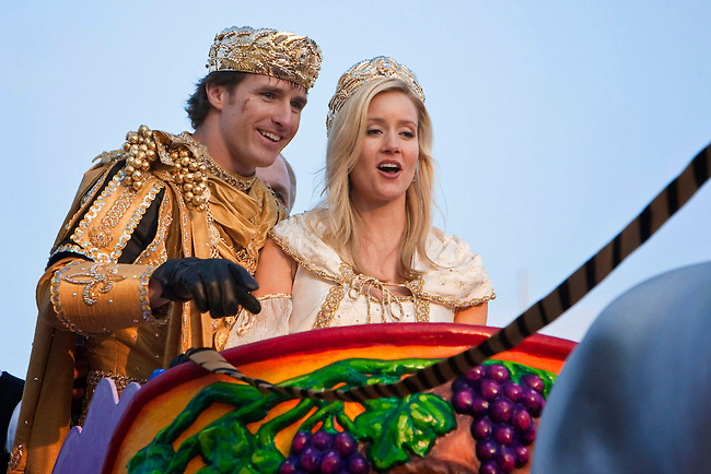 Super Bowl MVP and New Orleans Saints Quarterback Drew Brees #9 as reigning King of Bacchus accompanied by his wife Brittany on the King's float in the Krewe of Bacchus parade as they get ready to roll at Tchoupitoulas Street and Napoleon Avenue in New Orleans, Louisiana. USA.