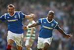 Sone Aluko celebrates his goal for Rangers along with Lee McCulloch