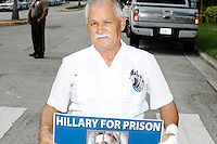 "With a small group of pro-Trump protesters, Pedro Roteta, 68, holds a sign reading ""Hillary for Prison"" before a campaign rally for Democratic presidential nominee Hillary Clinton in the Theodore R. Gibson Health Center at Miami Dade College-Kendall Campus in Miami, Florida, USA. The protesters shouted hateful language to people lined up to enter the rally. Roteta said he was a political prisoner in Cuba and has been an American citizen for 30 years."