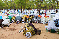 Pilgrims performing their collective Sallah prayer.